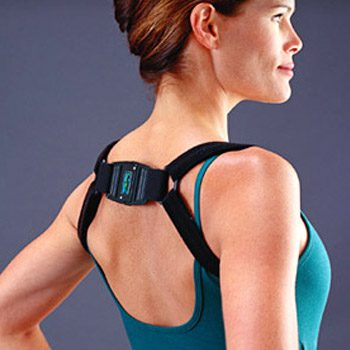 Woman wearing biofeedback posture trainer