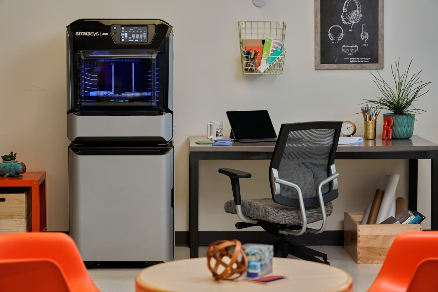 Stratasys J55 3D printer in an office setting