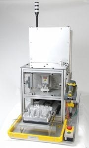 Close up view of reagent cartridge sealing automation