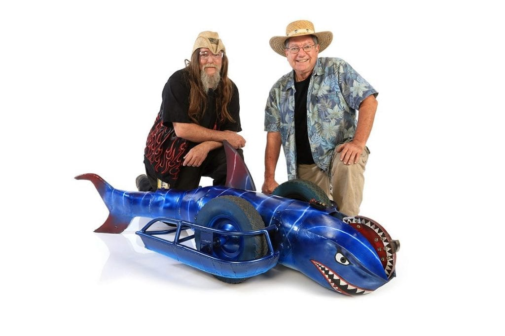 Ed Robinson, left, and John Hoffman, right, pose with their bot, Sharkoprion.