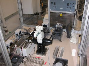Overhead view of a custom microplate-cleaning robot