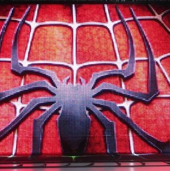 Outdoor LED video display showing Spiderman graphic